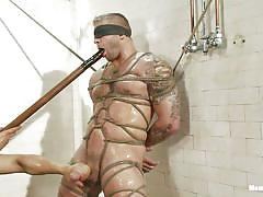 Muscled gay tied and pleasured under the shower