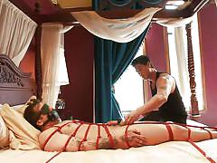 Tied up gay getting his dick rubbed and his feet tickled