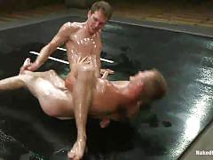 Pretty boys with oiled bodies wrestling
