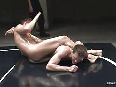 Oiled gays wrestling and fucking