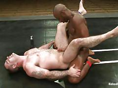 Black man shows a white boy how's the boss