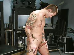 Tattooed gay and his butt fucking device