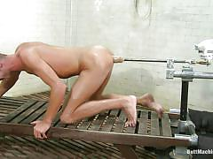 Shaved ass boy playing with his butt machine