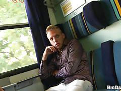 Naughty blond boy sucking cock on a train