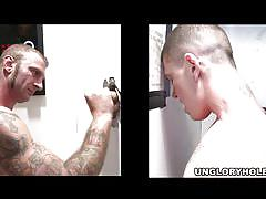 Sexy tattooed guys having gloryhole fun
