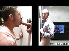 Horny hunk sucking cock from gloryhole