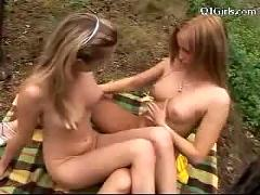 2 girls in fishnet tops kissing licking each others pussies nipples on a plaid in the forest