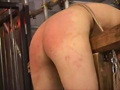 Asian girl bent over and whipped + spanked