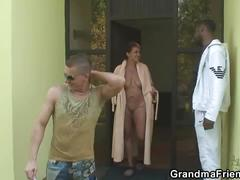 Mature brunette gets banged hard by two dudes