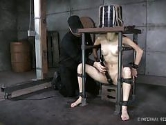 Slave gets a bucket on her head and pleasured with a vibrator