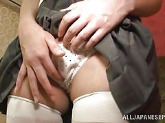 A vibrator on the schoolgirl's clit