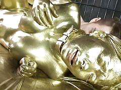 Elegant and horny japanese lady is fucked and covered in gold
