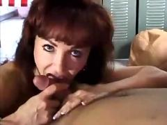 Cougar sucks cock down on her knees...f70
