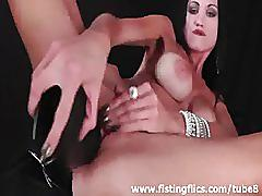 Stunning brunette milf fisted and fucked with huge toys