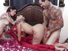 Two punk chicks share a cock