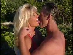 Lifeguard couple having fun in the garden