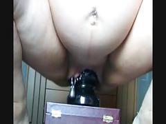 Pregnant milf rides huge dildo