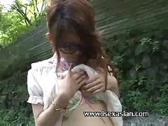 Asian big glasses having absolute sex outdoor