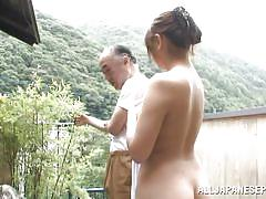 Young girl washes old man's cock