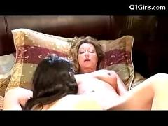 Slim girl rubbing pussy with older woman licking getting licked on the bed