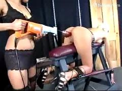 Blonde girl tied to platform in doggy getting fucked with fuck saw clit stimulated with vibrator by her mistress