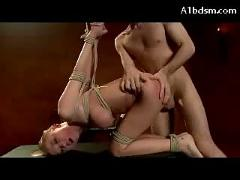 Busty girl hogtied hanging getting her pussy fucked stimulated with vibrator hot wax to her back by the master in the dungeon