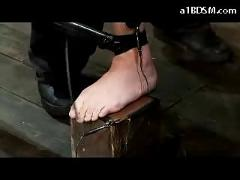 2 girls getting tied pussies stimulated with vibrator electricity to her feets in the dungeon
