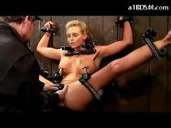 Busty blonde with nipple clips tied to wall getting her pussy fingered stimulated with vibrator whipped by the master