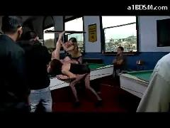 Busty slave girl with breast bondage on her knees sucking cock getting her pussy fucked in public on the pool desk