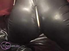 Sexy blonde in latex and leather shows off her body
