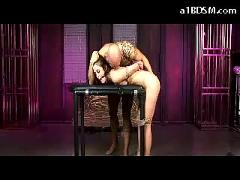 Slim girl tied and bended to desk mouthgag getting her pussy fucked from behind sucking cock in the dungeon