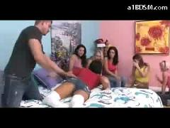 Girl in long socks getting her ass whipped giving blowjob on the bed in front of 5 girls