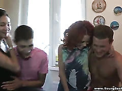 Foursome with redhead and asian teens