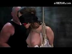 Blindfolded hogtied girl high heels and mouthgag hanging whipped nipples tortured pussy fingered in the dungeon