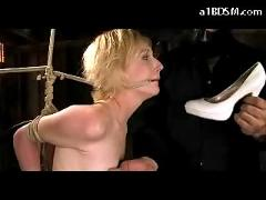 Slim blonde getting tied ass spanked to red in the dungeon