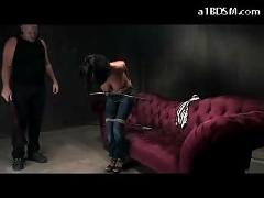 Busty girl in jeans mouthgag getting her nipples tortured whipped spanked sucking cock in the dungeon
