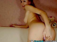 Petite blonde toys her pierced pussy