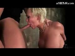 Busty blonde tied legs and arms getting her mouth and pussy fucked whipped on the bed in the basement