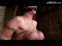Busty tattooed girl tied to chair strangled getting her tits bondaged mouthgag hanged with chair in the dungeon