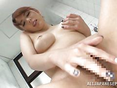 Tall japanese beauty fingers her tight pussy