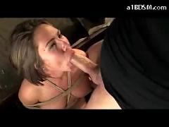 Blindfolded girl on her knees bondaged nipple clips sucking cock fucked on the bed licking cum from the blanke in the room