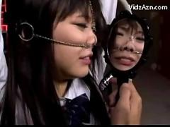 Schoolgirl in uniform with pignose tied to bedframe getting her mouth fucked