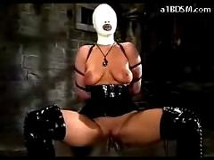 Girl in mask latex corset and boots tortured with clips whipped in the dungeon