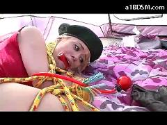 Blonde bondaged scout girl mouthgagged getting her pussy fucked stimulated with toys in the booth