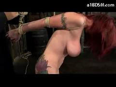 Busty tattooed redhead getting her arms tied tits rubbed and whipped pussy stimulated with vibrator