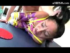 Hot girl tied legs and arms getting her pussy fingered fucked on the pingpong desk
