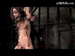 Slim girl with tied legs and arms vibrator between pussy whole body tortured with clips in the dungeon