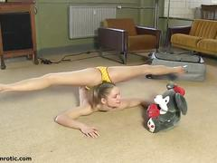 Flexible blonde teen poses and provokes you