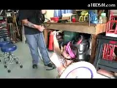 Girl dressed as teen with small bicycle mouthgagged tits rubbed and bondaged pussy rubbed with rope by the mechanic in the workshop