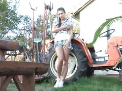 Beautiful brunette farmer girl masturbating on tractor